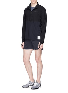 Satisfy 'Justice Race' mesh panel half zip performance top