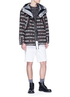 Sacai 'Vector' slogan print hooded parka