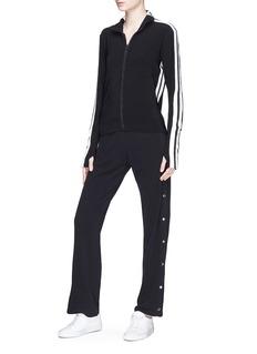 Norma Kamali Stripe trim turtleneck jacket