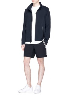 Reigning Champ Retractable hood track jacket