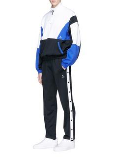 MAGIC STICK 'Euro Gang' snap button outseam jogging pants