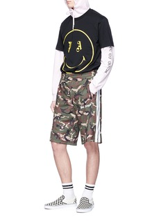 Palm Angels Stripe outseam camouflage print shorts