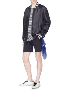 ATTACHMENT Slim fit nylon shorts