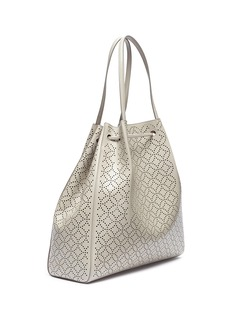 Alaïa Geometric lasercut leather bucket bag