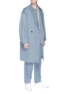 ETHOSENS Asymmetric hem colourblock wool top