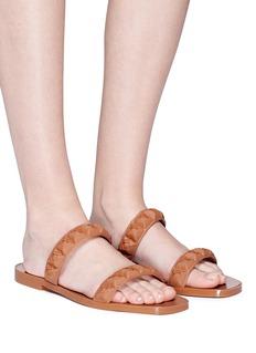 Stuart Weitzman 'Rosita' rose stud double band TPU slide sandals