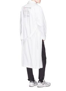 Yulia Yefimtchuk+ Belted Cyrillic print shirt coat