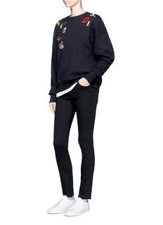 Alexander McQueenObsession charm embellished fleece sweatshirt