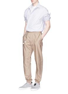 SIKI IM / DEN IM Mix stripe jogging pants