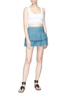 Alaïa Diamond cutout tiered knit mini skirt