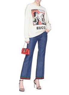 Gucci Bunny patch Web stripe cuff flared jeans