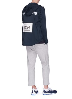 Satisfy 'Fast Lane' slogan print packable windbreaker jacket