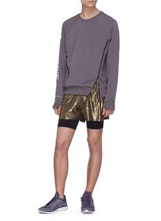 SIKI IM CROSS Metallic layered running shorts
