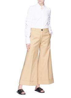 KHAITE 'The Carine' twill flared wide leg pants