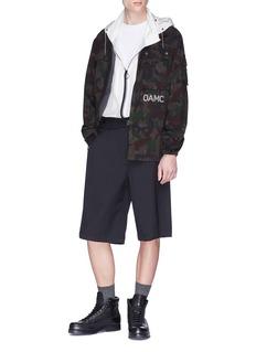 OAMC Slogan appliqué camouflage print twill shirt jacket
