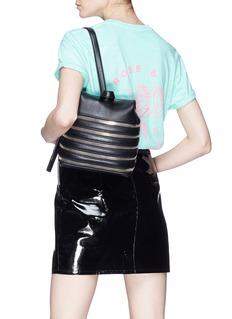 Kara Multi zip pebbled leather small backpack