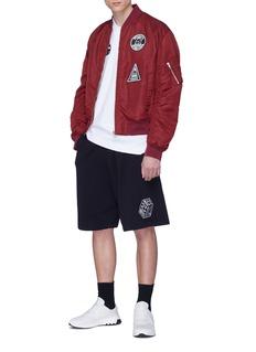McQ Alexander McQueen Cube logo appliqué drop crotch sweat shorts