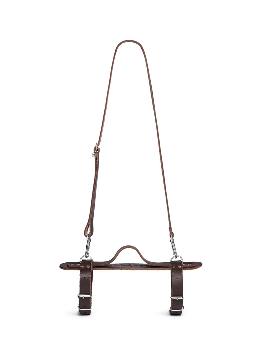 Leather towel carrier by The Beach People