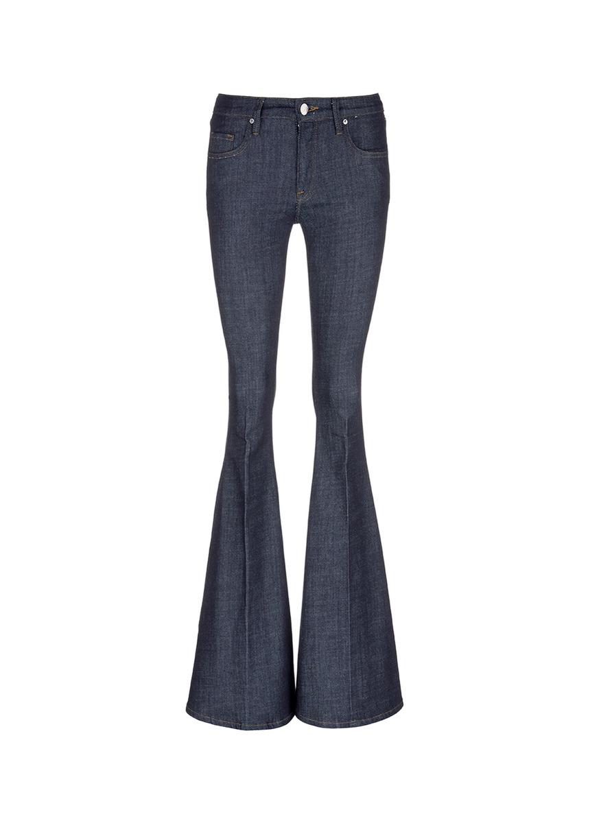 Slim fit raw denim flared jeans by VICTORIA, VICTORIA BECKHAM