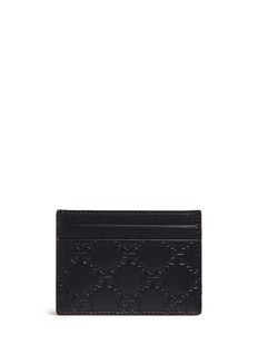 GucciDebossed logo leather card case