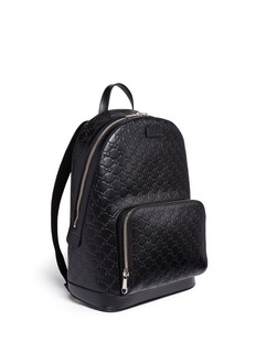 Gucci Debossed logo leather backpack