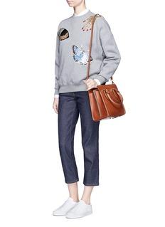 Alexander McQueenObsession charm sequin embellished fleece sweatshirt