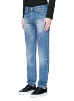 Back strap distressed jeans