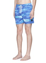 'The Olson' wave print swim shorts