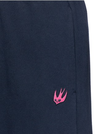 Detail View - Click To Enlarge - McQ Alexander McQueen - Swallow skull patch appliqué sweatpants