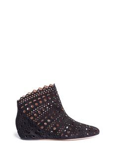 AlaïaGeometric lasercut suede ankle boots