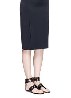 Alaïa Geometric lasercut leather thong sandals