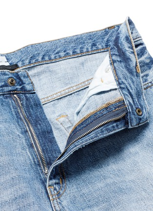COVERT - Frayed cotton jeans