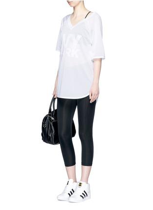 Ivy Park-Embroidered logo V-neck mesh T-shirt
