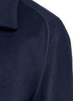 Piped sleeve balmacaan coat
