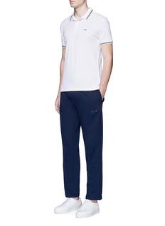 Armani CollezioniEagle logo print stripe polo shirt