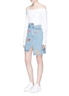 Ground ZeroMixed anime patch asymmetric denim skirt