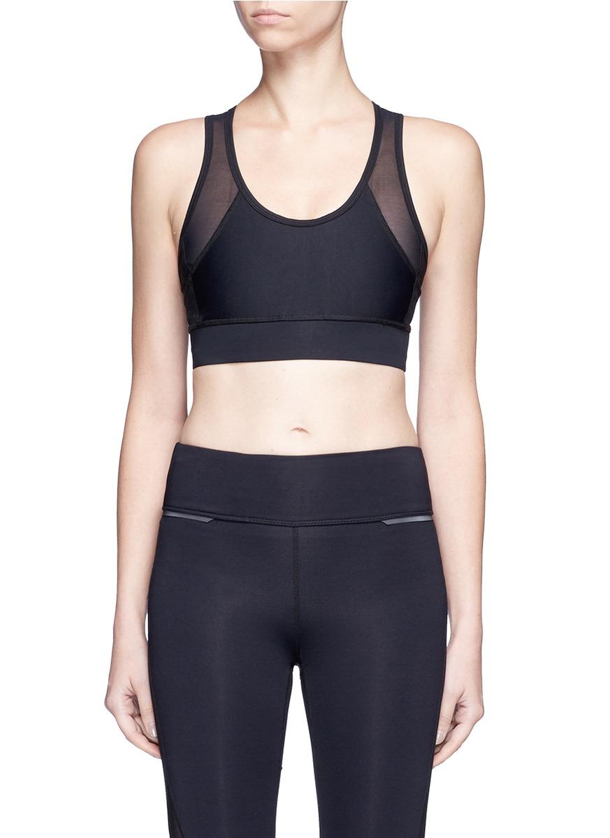 Zip It Up mesh panel sports bra by Alala