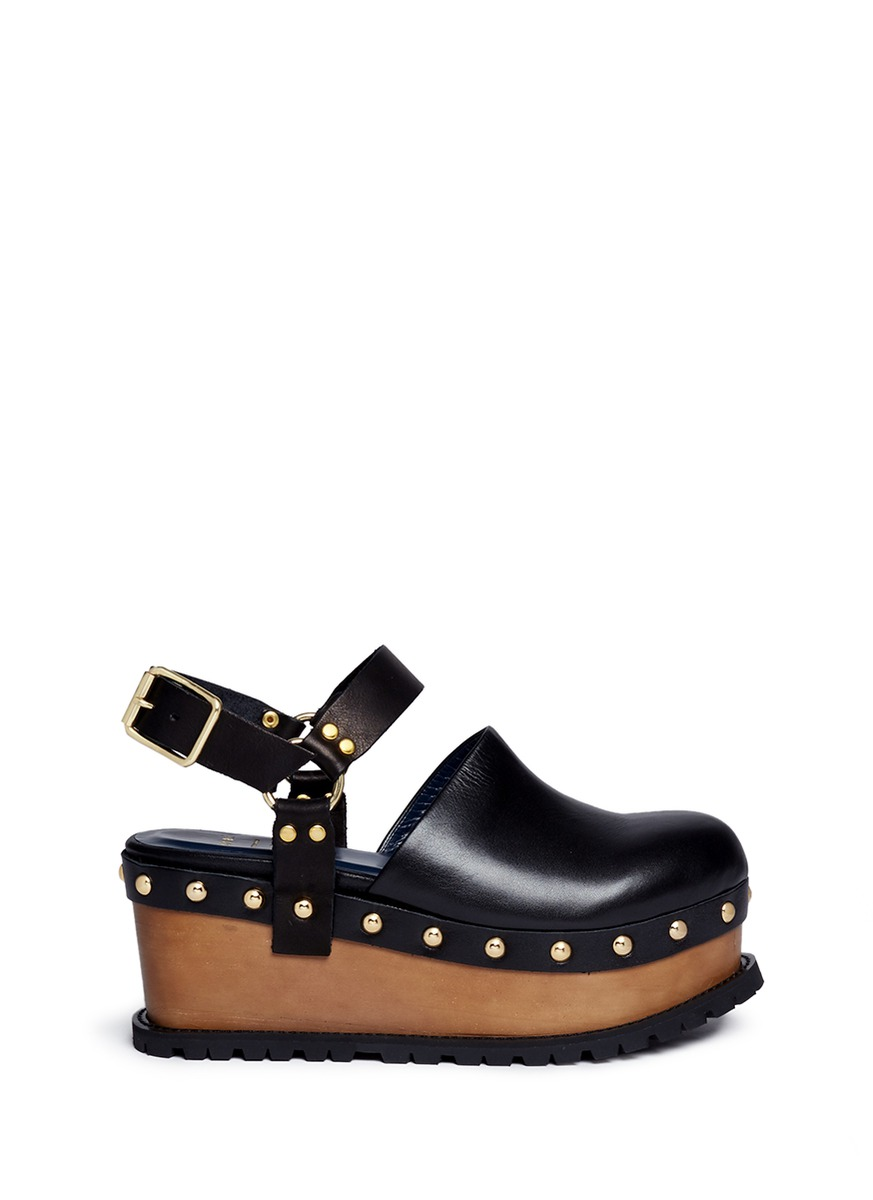 Wooden wedge stud leather clogs by Sacai