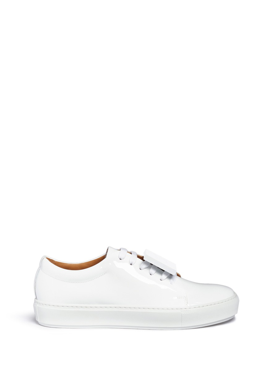 Adriana emoticon plate patent leather sneakers by Acne Studios