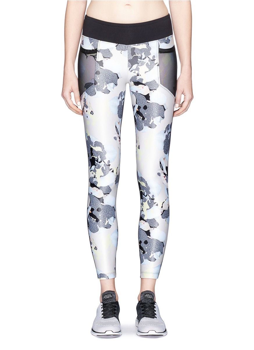 Magnify bloom print H2O performance leggings by KORAL