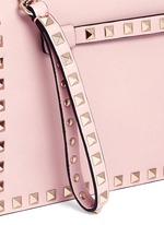 'Rockstud' leather flap clutch