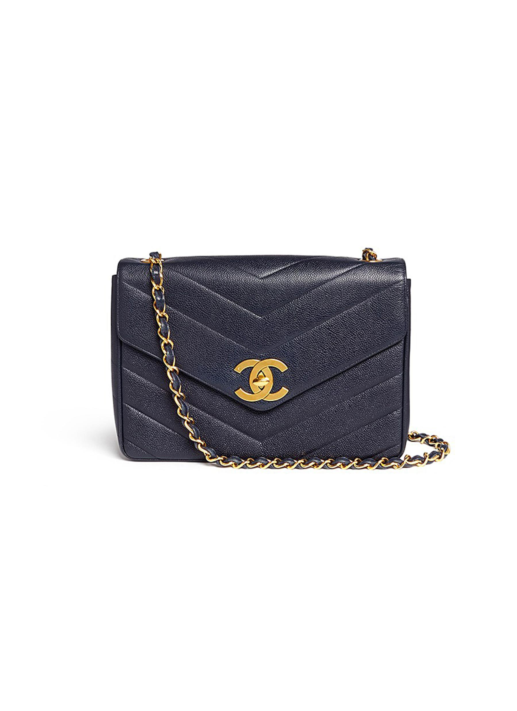 Jumbo chevron quilted caviar leather flap bag by Vintage Chanel