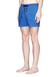 DANWARDMid length geometric print swim shorts