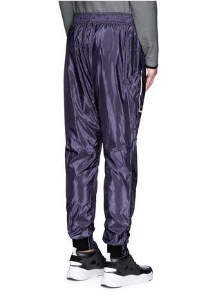 背面 - 点击放大 - DYNE - 反光拼贴防水运动裤