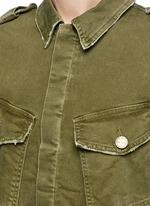 Distressed denim military jacket