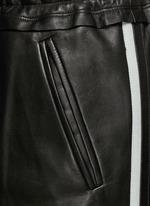 拼色条纹羊皮运动裤