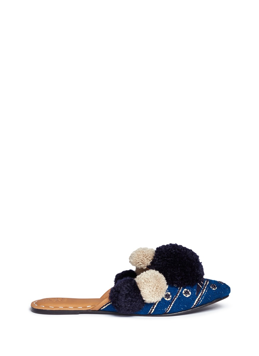 Iris pompom embroidered leather slides by FIGUE SHOES