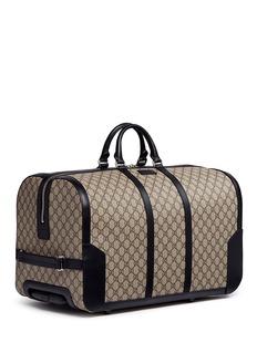GucciGG Supreme canvas trolley duffle bag