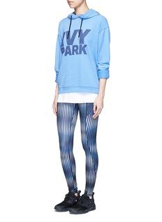 Ivy Park'K Print' electric stripe print performance leggings