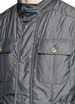 Retractable hood vest